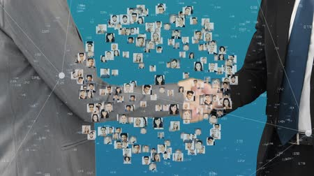сотрудники : Digital composite of a handshake between business people and globe made up of profile pictures Стоковые видеозаписи