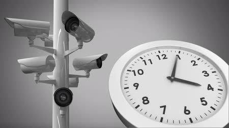 beside : Digital animation of  surveillance cameras beside a clock