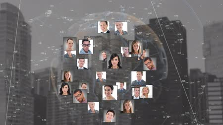 expanding : Digital composite of a globe with profile photos expanding and contracting on a cityscape background