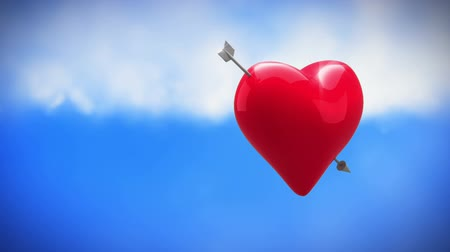 fondness : Digital animation of a rotating heart with cupid arrow on a sky background