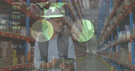 engradado : Front view of a male Caucasian worker wearing a hard hat writing on a clipboard while checking packages on shelves. Digital animation of graphs and statistics are running in the foreground 4k Stock Footage