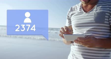follower : Close up of a Caucasian man standing on the beach while typing on his phone. Beside the man is a digital animation of a message bubble with a follower icon and a number count up 4k