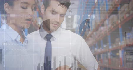 crate : Close up of Caucasian male and female supervisors inside a warehouse writing on a clipboard checking inventory. Digital animation of graphs and statistics are running in the foreground 4k