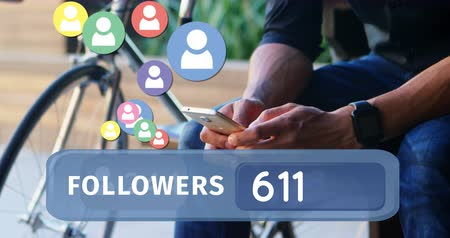 representação : Close up of a man seated beside a bicycle typing on his phone while checking his wrist watch. Digital animation of a followers count bar with icons flying upwards is seen in the foreground. 4k