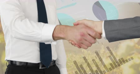 kifinomult : Close up of a handshake between two businessmen with digital animation of graphs and statistics running in  the background 4k