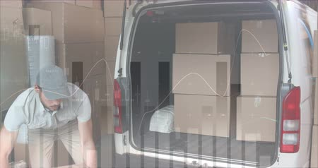 engradado : Rear view of a Caucasian deliveryman loading packages in the back of a delivery van. He then pauses and smiles at the camera. Digital animation of graphs and statistics are running in the foreground 4k