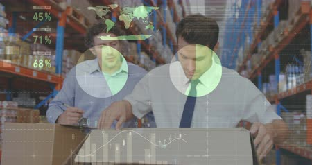 rakomány : Close up of two Caucasian male warehouse managers. One of them is opening a package while the other spectates from behind. Digital animation graphs and statistics are running int the foreground 4k Stock mozgókép