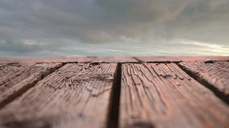 celestial : Close up of a wooden deck with a low angle view of a cloudy sky