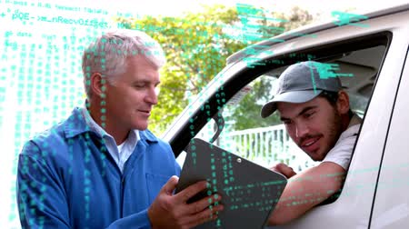 доставлять : Close up of a Caucasian male manager discussing with his deliveryman while holding up a clipboard. Digital animation of binary codes are running in the foreground Стоковые видеозаписи