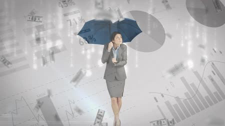 us banknotes : Digital animation of a businesswoman holding up an umbrella while it rains dollar bills. Graphs and statistics are running in the foreground Stock Footage