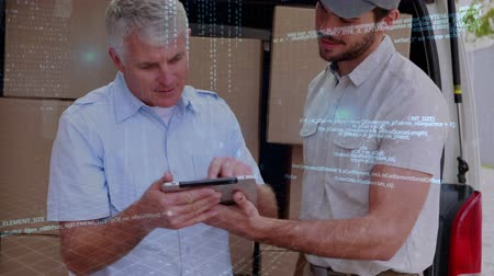 クーリエ : Close up of a Caucasian delivery man with his Caucasian manager looking into a clipboard behind a delivery van. Digital program codes are running in the foreground.
