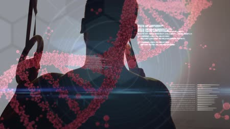 dvojitý : Silhouette of a man on pull up bars with a digital composite of DNA helix rotating in the foreground. Labels and codes are running in the forground Dostupné videozáznamy