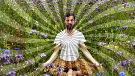 abandonment : Close up of a Caucasian man meditating in the garden with a spiralling effect Stock Footage