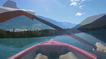 гребля : Front view of the mountains while kayaking on the lake Стоковые видеозаписи