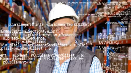 クーリエ : Close up of a warehouse manager raises his head and smiles. Behind him are shelves filled with packages. Digital animation of a program codes are running in the foreground
