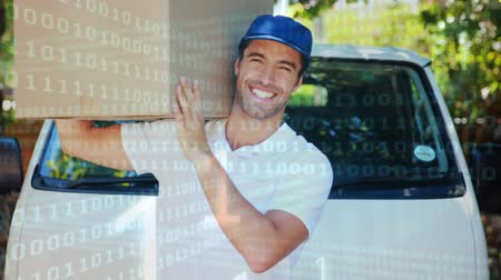 engradado : Close up of a deliveryman giving a thumbs up while carrying a package. Behind him is a parked delivery van. Digital animation of binary codes are running in the foreground Stock Footage