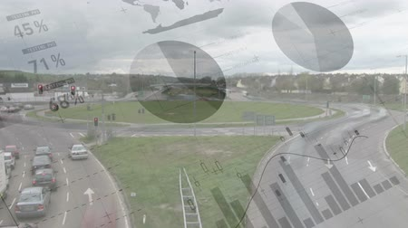 межгосударственный : High angle of a highway intersection filled with moving cars. Digital animation of graphs and statistics are running in the foreground