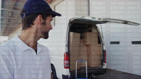 engradado : Close up of a deliveryman behind a van writing on a clipboard gives a thumbs up Stock Footage
