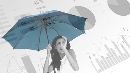 выигрыш : Close up of a shocked and scared woman holding up an umbrella with graphs and statistics running in the foreground