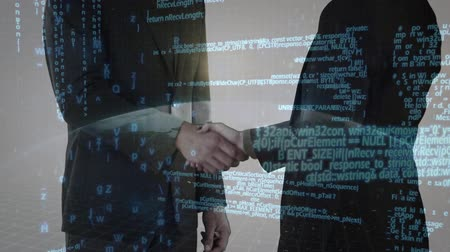 alcançando : Digital composite of two businessmen shaking hands with digital globe and interface codes in the foreground