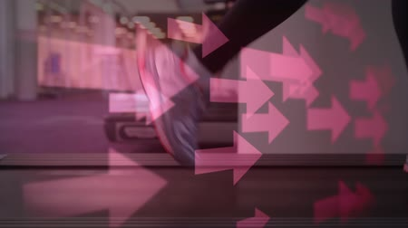 indicar : Digital composite of legs running on a tread mill with arrows pointing to the right Stock Footage
