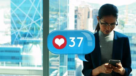 interaktivní : Digital composite of woman wearing glasses texting on her phone. Beside her is a digital animation of message bubble with heart icon and number count up