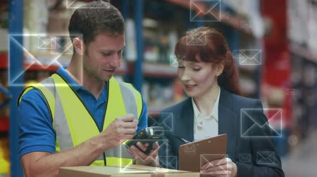 сканер : Digital composite of a Caucasian female warehouse manager and her Caucasian male worker with email icons in the foreground. The manager and the worker are comparing data from a scanner and a list Стоковые видеозаписи