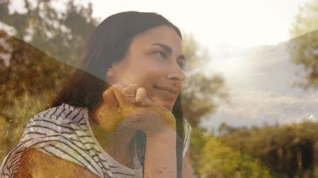parkland : Side view of Hispanic woman holding her chin and smiling at park Stock Footage