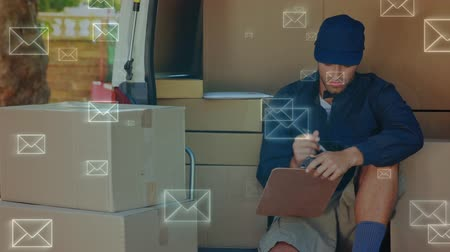 tektura : Digital composite of Caucasian delivery man counting packages on a van while sitting. Envelopes can be seen moving in the foregound