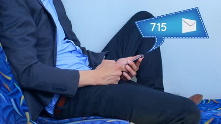 tárcsázás : Digital composite of a man in business casual clothes sitting while using cellular phone and message bubble icon shows increasing numbers.