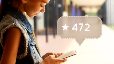 tárcsázás : Digital composite of a young Caucasian girl using a mobile phone with a social media icon with a star and increasing numbers on the side