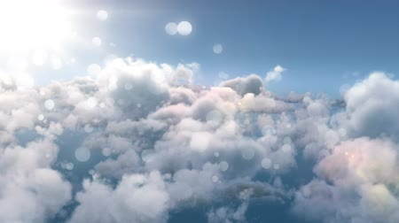 jiskry : Digitally generated animation of white bokeh moving with background of above the clouds with the sun