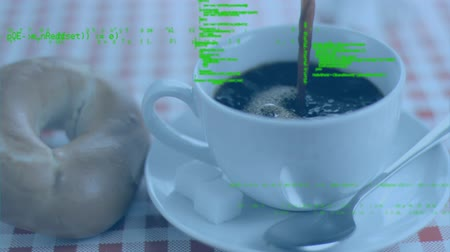 command : Digital animation of codes moving in the screen while background shows coffee poured in a cup beside a bagel.