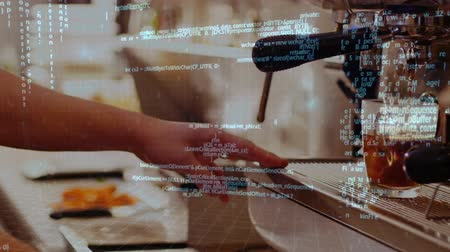 being prepared : Digitally generated animation of program codes moving in the screen while background shows coffee being prepared in a coffee machine. Stock Footage