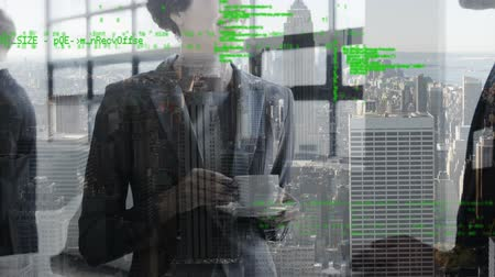 сотрудники : Digital composite of Caucasian businessman and businesswoman talking in the office over coffee while background shows a view of the city and program codes move in the foreground.