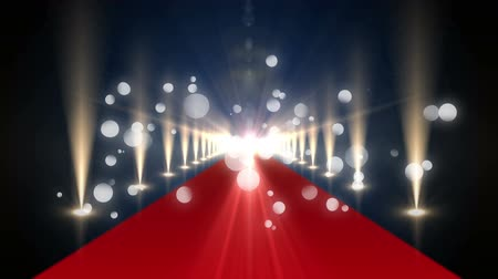 fama : Digitally generated animation of bokeh lights moving in the screen while background shows a red carpet