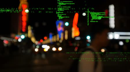 comando : Digital animation of program codes moving in the screen with background of a street view in the evening.