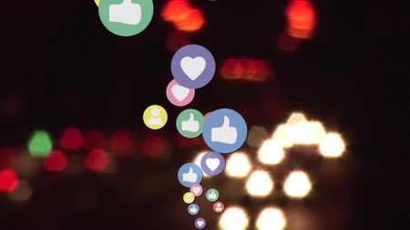 inbox : Digital animation of a social media icons moving up with a background of a busy highway with cars in the night