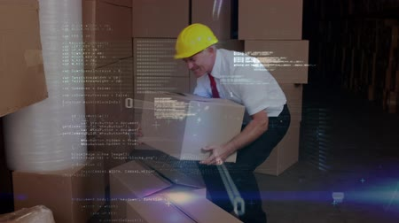 comando : Digital composite of an adult Caucasian man wearing a safety hat putting a box down and hurting his back while program codes move in the foreground