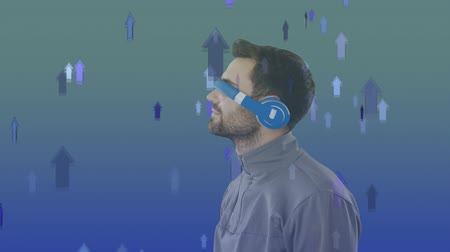 indicating : Digital composite of a Caucasian man using virtual goggles with background of arrows moving upwards Stock Footage