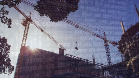 タイプスクリプト : Digital animation of binary codes moving in the screen with a background of tower crane in construction