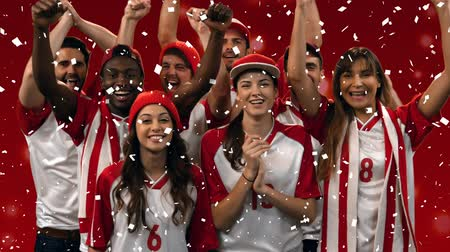 toeschouwers : Digital composite of a group of diverse fans wearing uniforms cheering while confetti fall
