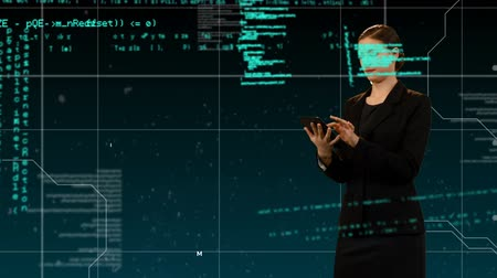sítě : Digital composite of a Caucasian woman in black using a tablet while program code moves in the screen