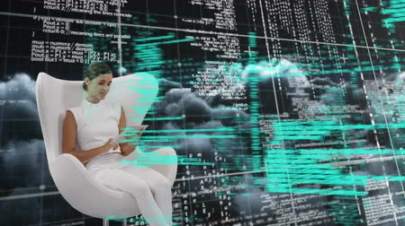databáze : Digital composite of a Caucasian woman sitting in a white chair while binary and program codes move in the foreground and background of dark clouds