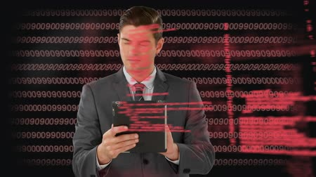 presleme : Digital composite of a Caucasian businessman using a tablet while binary codes and program codes move in the background Stok Video