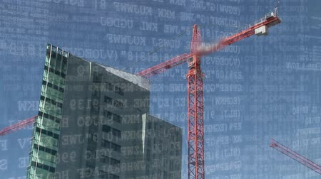 el yazısı : Digital animation of binary codes moving in the screen with background of a crane beside a building