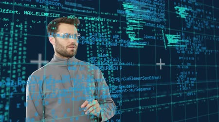 kifinomult : Digital composite of a Caucasian man using a touchscreen while program codes move in the screen