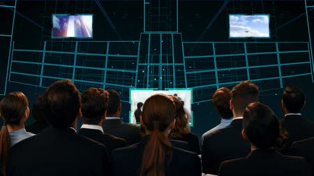 kifinomult : Digital composite of diverse business people watching a digital stage with lcd screens showing different videos Stock mozgókép