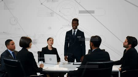 lugares sentados : Digital composite of diverse business people discussing inside an office having a meeting while graphs and asymmetrical lines moving in the background Stock Footage