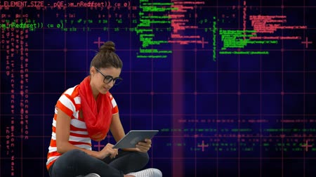 command : Digital composite of a Caucasian woman using a tablet while seating on the floor with program codes moving in the screen